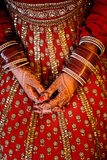 Indian Bride's hands wearing bangles decorated with beautiful he Stock Photography