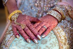 Henna Hands. Indian brides hands showing henna designs and jewelry royalty free stock photo
