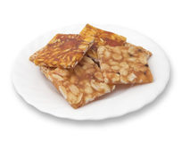 Indian brittle over white. Various kinds of Indian sweet brittle on a plate royalty free stock photo
