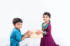 Indian brother and sister celebrating rakshabandhan or rakhi festival Royalty Free Stock Images