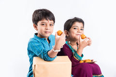 Indian brother and sister celebrating rakshabandhan or rakhi festival Royalty Free Stock Photo