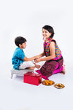 Indian brother and sister celebrating rakshabandhan or rakhi festival Royalty Free Stock Photos