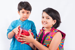 Indian brother and sister celebrating rakshabandhan or rakhi festival Stock Photos