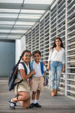 Indian brother and sister. Preteen Indian girl posing wither little brother Royalty Free Stock Image