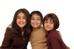 Indian brother and two sisters. Brother and sisters isolated on white background Stock Image
