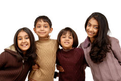 Indian brothers and three sisters. Brother and sisters on a cold winter day Royalty Free Stock Images