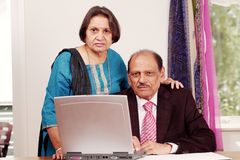 Indian business couple. Senior indian business couple in home office Royalty Free Stock Images