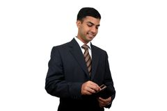 Indian business man (2). Indian business man taking out his credit card (2) with clipping path Stock Photo
