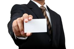 Indian business man. Indian business man holding name card with clipping path Stock Photography