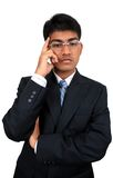 Indian business man. An Indian business man thinking Royalty Free Stock Photo