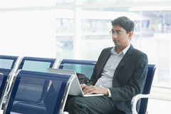 Indian business man at airport Royalty Free Stock Photos