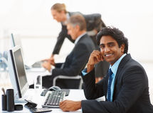 Indian business man with colleagues at the back Royalty Free Stock Images