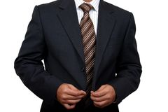 Indian Business man getting ready to go to office (1). Business man getting ready to go to office (1) with clipping path Royalty Free Stock Photography
