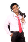 Indian business man hearing music Stock Images