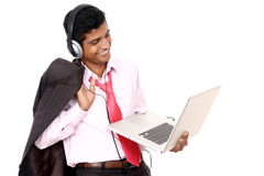 Indian business man hearing music Stock Photography