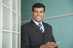 Indian business Man holding his Smart phone. Stock Photos