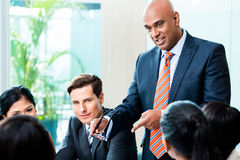 Indian Business man leading team meeting Stock Photos