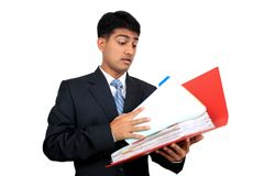 Indian business man looking at a file. Royalty Free Stock Images