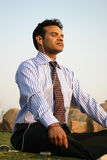 Indian business man meditating Stock Image