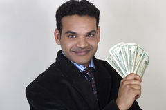 Indian business man with money Stock Images