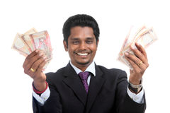 Indian business man with money Stock Photography