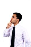 Indian business man in thinking pose Royalty Free Stock Photo