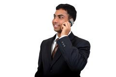 Indian business man using cellphone (1). With clipping path Stock Photos