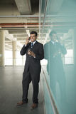 Indian business Man using his Smart phone. Stock Images