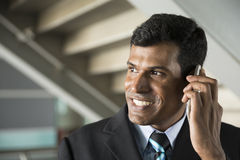 Indian business Man using his Smart phone. Stock Image