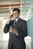 Indian business Man using his Smart phone. Stock Photography