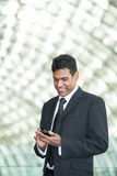 Indian business man using mobile phone. Royalty Free Stock Photos