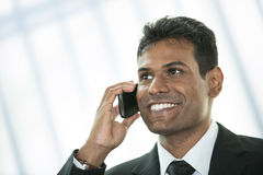 Indian business man using mobile phone. Stock Photography