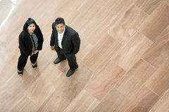 Indian business man and woman looking up. Royalty Free Stock Photography