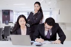 Indian business manager watching over her staff stock photos