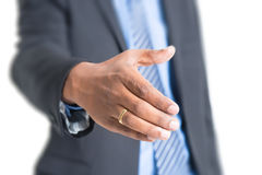 Indian business people hand offering handshake Royalty Free Stock Images