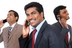 Indian business people talking in mobile phone Royalty Free Stock Images