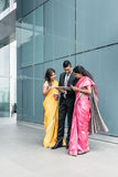 Indian business people using high-tech devices during break Stock Images
