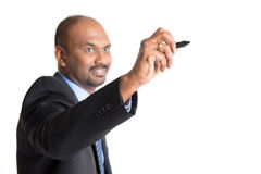 Indian business people writing. Mature Indian business male in formalwear writing something on glass board with marker, focus on hand Royalty Free Stock Image