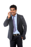 Indian business professional talking in mobile Stock Photo