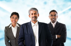Indian business team. Asian Indian businessmen and businesswoman in group. Teamwork concept standing inside office building. Good looking Indian model Stock Image