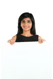 Indian Business Woman displaying white placard for your text. Royalty Free Stock Photography