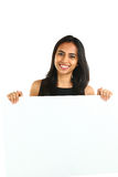 Indian Business Woman displaying white placard for your text. Royalty Free Stock Photos