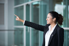 Indian business woman pointing to distance Stock Photography