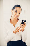 Indian business woman sending text message mobile phone happy Stock Images