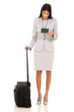 Indian business woman. Smart indian business woman looking at air ticket isolated on white Royalty Free Stock Photo