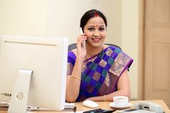 Indian business woman talking on mobile phone. Traditional Indian business woman talking on mobile phone Royalty Free Stock Photo