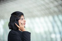 Indian business woman using mobile phone. Stock Image