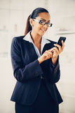 Indian business woman using mobile phone happy Royalty Free Stock Photos