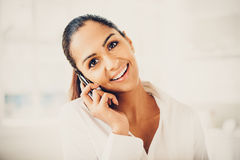 Indian business woman using mobile phone happy Stock Photography