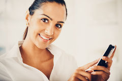 Indian business woman using mobile phone happy Stock Image